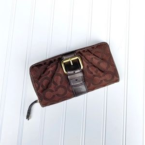 Brown coach buckle wallet with leather interior